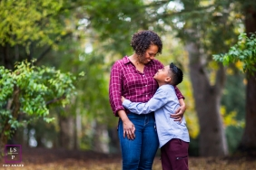 A young man holds his mother for a beautiful family portrait in San Francisco, CA