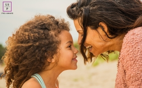Mom and daughter laugh together for this beach lifestyle portrait session