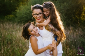 A France mother and  her two daughters pose for a lifestyle portrait