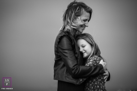 Mom and daughter hold each other for this France Lifestyle Portrait