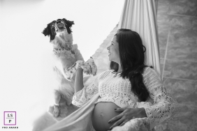 Rio de Janeiro maternity portrait of pregnant woman with her happy dog