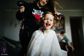 Lifestyle kids portrait of little girl with a home visiting hairdresser