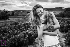 Outdoor France lifestyle parent/child portrait session in Auvergne-Rhone-Alpes with A big hug from mom