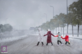 Winter lifestyle kids pictures from Hunan China of the family walking In the snow
