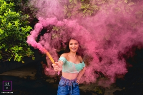 Brazil lifestyle teen photography in Santa Catarina showing The magic of colors inside a smoke grenade