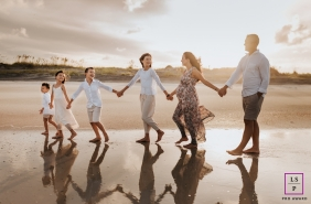 Nashville family and lifestyle maternity photography during a beach session with mom, dad and four kids from Tennessee