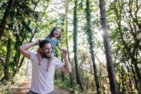 France dad and Daughter portrait during a lifestyle family photography session in the wooded trees of Bourgogne-Franche-Comte