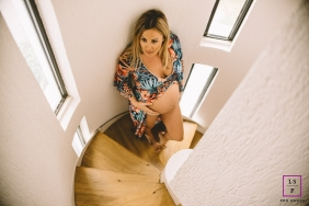 An Attica lifestyle maternity portrait session in Athens with a pregnant woman on the stairs