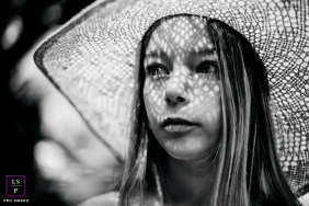 Outdoor lifestyle teen portrait session under a sun hat in Castelldefels, Spain