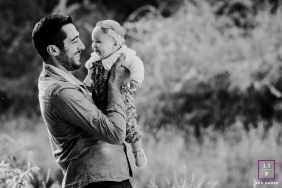 An outdoor France lifestyle portrait shoot with Father & daughter, and the mountain of Pyrénées-Orientales
