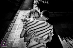 A Pyrenees-Orientales Big hug lifestyle couple portrait shoot on the streets of Perpignan