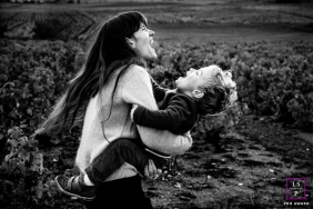Auvergne-Rhone-Alpes mom having fun with her boy in the fields of France during a family portrait session