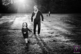 Marseille photoshoot of a family running aross a lawn during this France lifestyle session