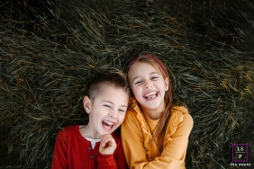 Auvergne-Rhone-Alpes brother and sister in laughter during a France family portrait shoot