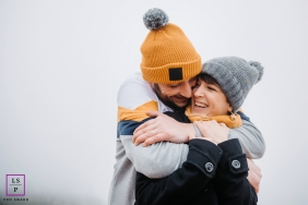 Auvergne-Rhone-Alpes love hug in the fog during a couple's shoot in France