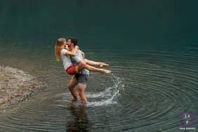 Seattle husband and wife playing in water for a couple portrait session in Washington