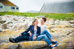 Brittany coast couple portrait of lovers sitting together on the rocks