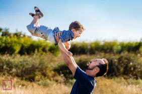 Perpignan lifestyle outdoor family fun picture session with dad lifting son up high