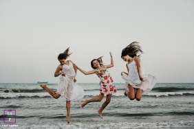 Sisters having fun on the beach in Spain during lifestyle photo shoot