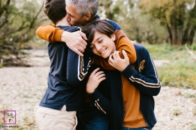 Bourgogne-Franche-Comte dad holding his boys, showing love to them in this family photo session