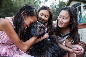 CaliforniaSisters time with their furry baby during a family portrait session