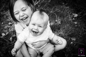 French Lifestyle Photographer created this artistic portrait with A young sibling who laughs