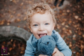Artistic Ain Lifestyle Photography of a young child with their stuffed toy