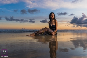 Maceio Lifestyle Photographer created this artistic portrait of a beutiful girl in the water at the beach at sunset