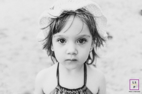 Alagoas Creative Lifestyle Portrait image of a very young girl standing at the beach
