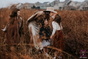 Artistic Nashville Lifestyle Photography of a mother in the tall grasses with her daughters