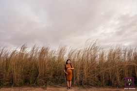 Roraima Mother posing for a Lifestyle Maternity Portrait in a field of tall grasses