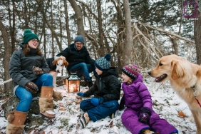 """Ontario, Canada Family posing for a Lifestyle portrait session during their annual """"solstice walk"""", where they sing carols and light lanterns"""