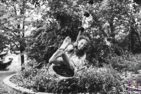Toronto young girl poses for a Lifestyle Portrait Session while swinging on a tree, her barefeet dirty from running around her backyard