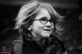 East Flanders boy with glasses poses for a lifestyle portrait shown in black and white