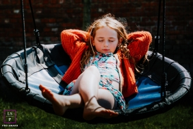 Flanders girl poses for a Lifestyle Portrait Session on a large swing
