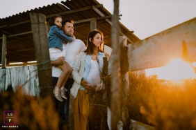Herault Family posing for a Lifestyle Maternity portrait at sunrise