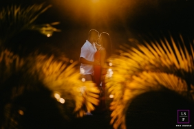 Minas Gerais couple posing for a creative Lifestyle image with afternoon light and palms