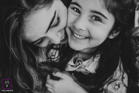 Campo Grande mother and daughter pose for a lifestyle portrait with tight cropping in BW