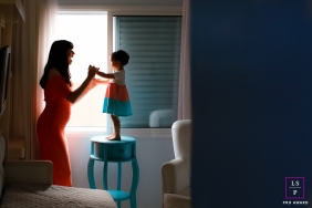 Parana mother and young girl pose for a maternity portrait playing in the window light