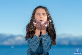 Lake Tahoe girl poses for a Lifestyle Portrait Session playing in the snow