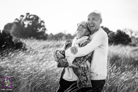 Perpignan couple posing for a creative Lifestyle image in a field of grass in black and white