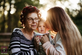 Portland Family posing for a Lifestyle portrait of grandma, daughter and granddaughter