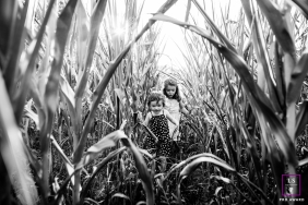 Rhone Kids Lifestyle portrait of two girls playing in the cornfields