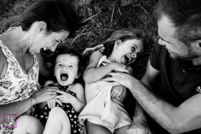 Rhone Family posing for a Lifestyle portrait with lots of hugs and tickles