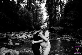Rhone woman with her mother posing for a Lifestyle Maternity Portrait while hugging in the forest