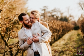 Rhone couple posing for a creative Lifestyle image while playing with happiness in the orchard