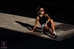 Perpignan young woman poses for a Lifestyle Portrait Session while taking an urban skateboard Break in the sun