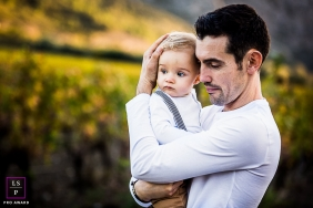 Perpignan father posing for a Lifestyle portrait with child who is Hugging dad