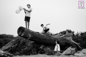 France Family posing for a Lifestyle portrait showing 1, 2 & 3 on the tree