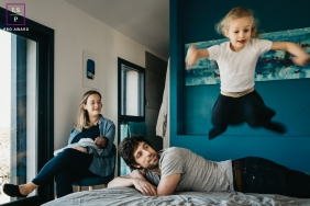 Collioure Family posing for a Lifestyle portrait session at home on the bed in France
